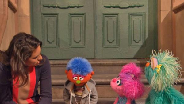 Alex, a Muppet whose parent is in jail, and several Sesame Street cast members appear in a video for Sesame Workshops Little Children, Big Challenges: Incarceration initiative. - Provided courtesy of 2013. Sesame Workshop. All rights reserved.