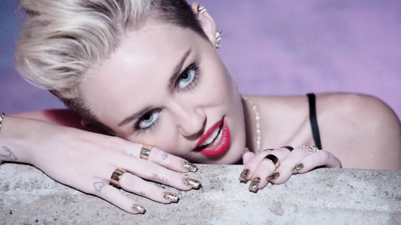 Miley Cyrus appears in a scene from her music video for We Cant Stop, released on June 19, 2013.