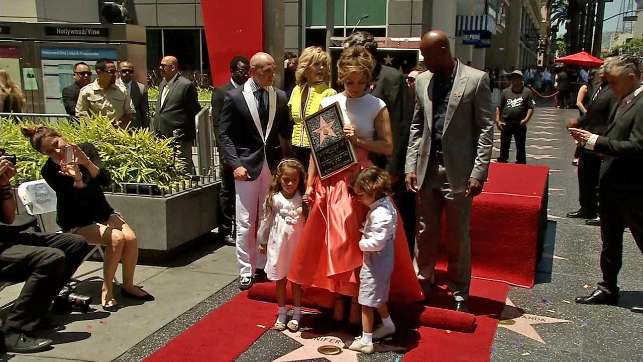 Jennifer Lopez appears with her twins Max and Emme at her star ceremony on the Hollywood Walk of Fame on June 20, 2013.