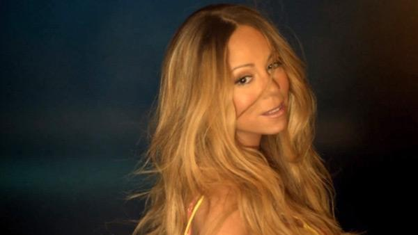 Mariah Carey appears in a scene from her 2013 single #Beautifuls music video. - Provided courtesy of youtube.com/mariahcarey / The Island Def Jam Music Group