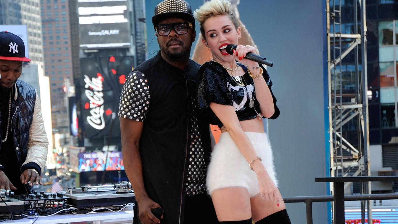 Miley Cyrus appears on ABCs Good Morning America on June 26, 2013. She wore a black and white outfit featuring thigh-high boots and performed We Cant Stop and Fall Down with special guest will.i.am.