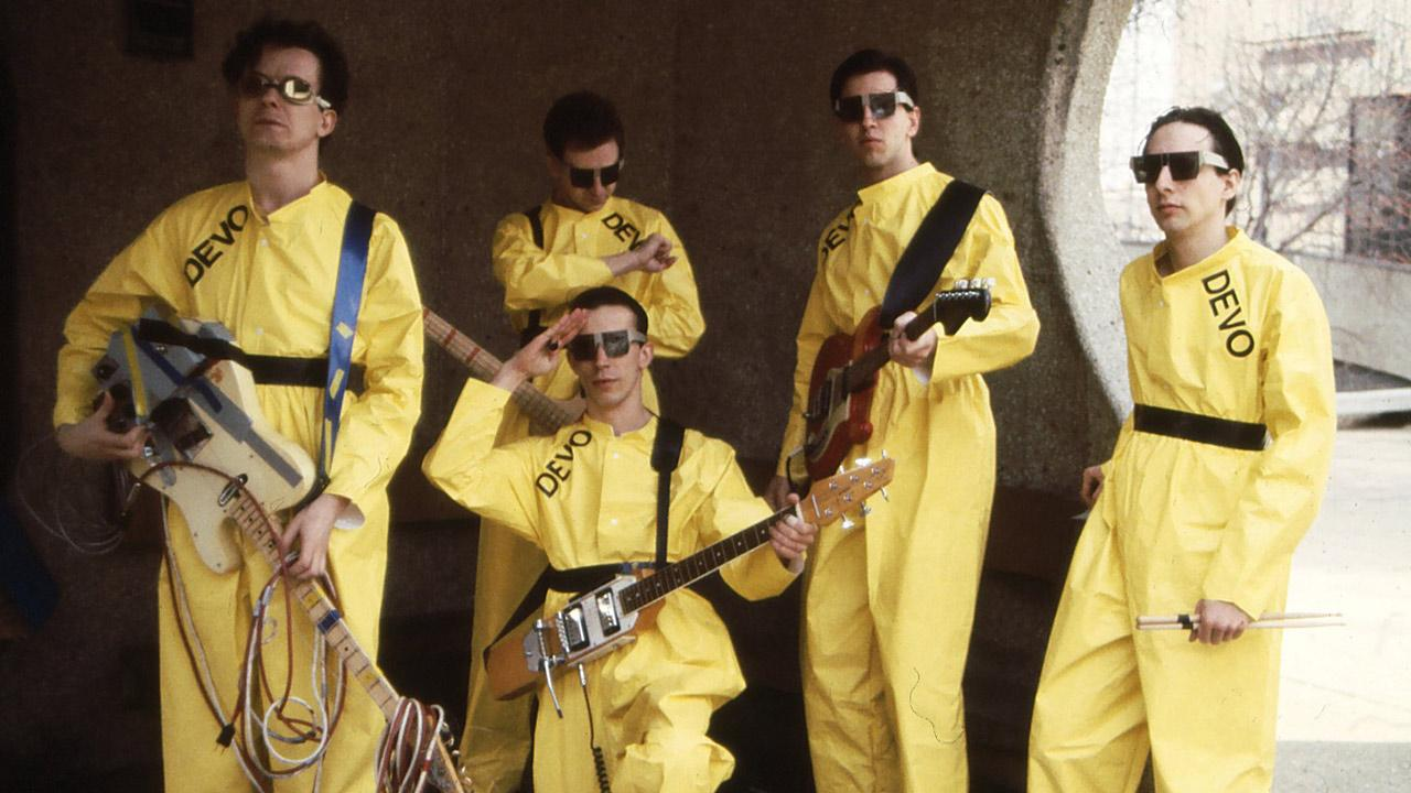 Devo members Mark Mothersbaugh, Bob Mothersbaugh, kneeling, Jerry Casale, Bob Casale and Alan Myers pose in a 1978 photo.Devo Inc. / Janet Macoska