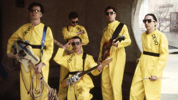 Devo members Mark Mothersbaugh, Bob Mothersbaugh, kneeling, Jerry Casale, Bob Casale and Alan Myers pose in a 1978 photo. - Provided courtesy of Devo Inc. / Janet Macoska