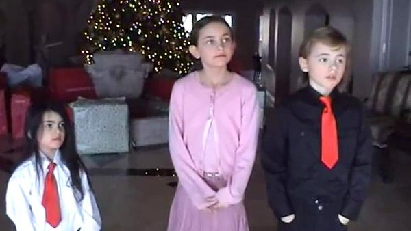 Michael Jacksons children, Blanket, Paris and Prince, stand in front of a Christmas tree and presents in this scene from an undated home video. In the clip, the singer, who is behind the camera, asks the kids what they want to do when they grow up. - Provided courtesy of OTRC / Official trial exhibit - Los Angeles Superior Court