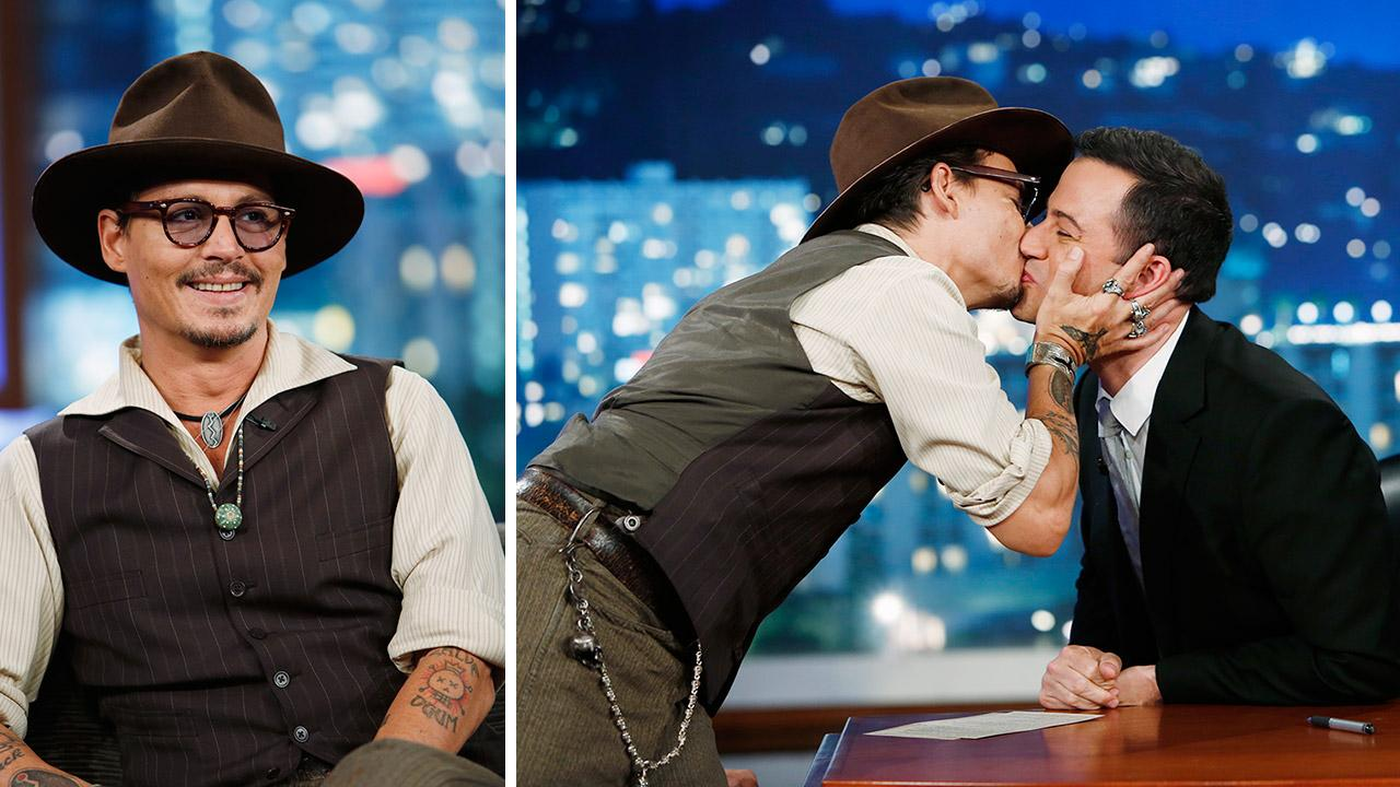 Johnny Depp kisses host Jimmy Kimmel on the ABC late-night talk show Jimmy Kimmel Live! on July 1, 2013. Depp appeared on the program to promote the new Disney film The Lone Ranger, in which he plays Tonto.