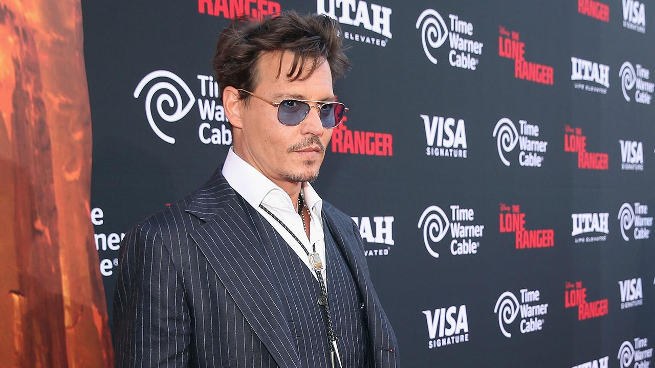 Johnny Depp appears at the premiere of The Lone Ranger in Disneylands California Adventure Park on June 22, 2013. <span class=meta>(Christopher Polk &#47; WireImage &#47; Walt Disney Company)</span>
