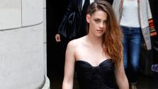 Kristen Stewart departs after the show of fashion designer Zuhair Murads Haute Couture Fall-Winter 2013-2014 show, presented on Thursday, July 4, 2013 in Paris. - Provided courtesy of AP / Francois Mori