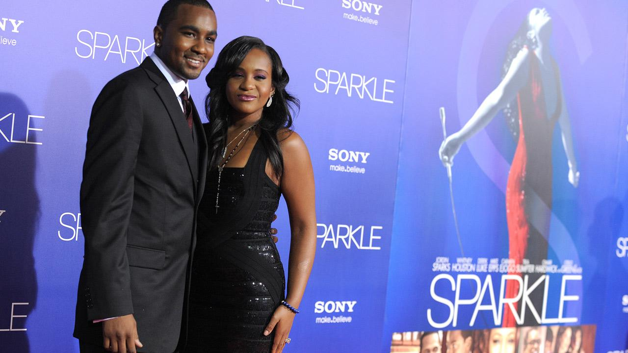 Bobbi Kristina Brown, daughter of the late Whitney Houston, and Nick Gordon appear in a photo posted on her Facebook page on July 10, 2013. / The two attend the L.A. premiere of Sparkle at Graumans Chinese Theatre in Los Angeles on Aug. 16, 2012.