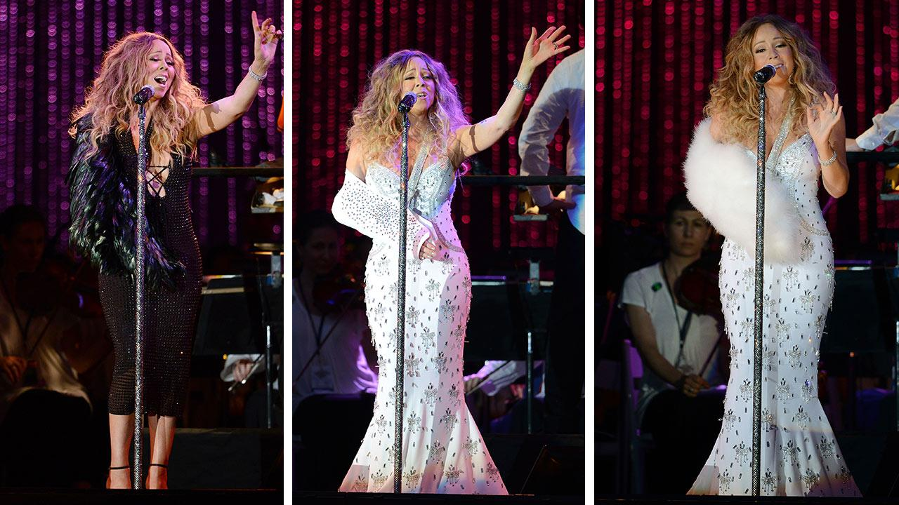 Mariah Carey, wearing fancy slings, performs with the New York Philharmonic at the 2013 MLB All-Star Charity Concert, benefiting Hurricane Sandy relief efforts, in New York Citys Central Park on July 13, 2013.