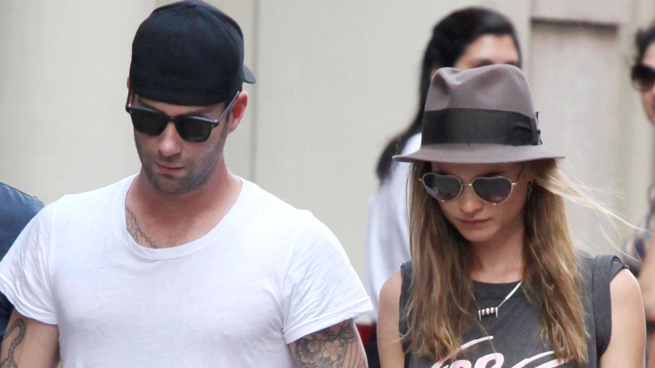 Adam Levine (in town to film his new movie Can a Song Save Your Life?) and girlfriend walking in Soho with a friend on July 1, 2013. <span class=meta>(Adam Nemser&#47;startraksphoto.com)</span>