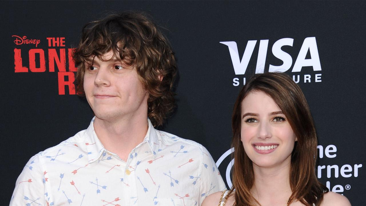 Evan Peters and Emma Roberts appear at the premiere of The Lone Ranger in New York City on June 22, 2013.