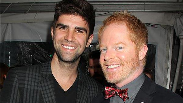 Justin Mikita and Jesse Tyler Ferguson appear at a screening of Star Trek Into Darkness in New York City on May 9, 2013. - Provided courtesy of Dave Allocca/Startraksphoto.com