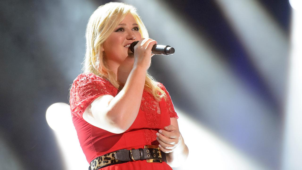 Kelly Clarkson performs during the CMA Music Festival: Countrys Night To Rock on July 17, 2013. The program will air on Aug. 12 at 8 p.m. on ABC.
