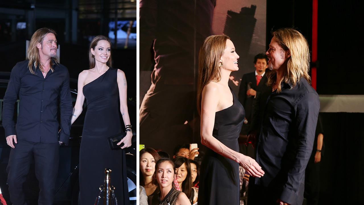 Angelina Jolie and partner and cast member Brad Pitt attend the World War Z premiere at Roppongi Hills in Tokyo, Japan on July 29, 2013.