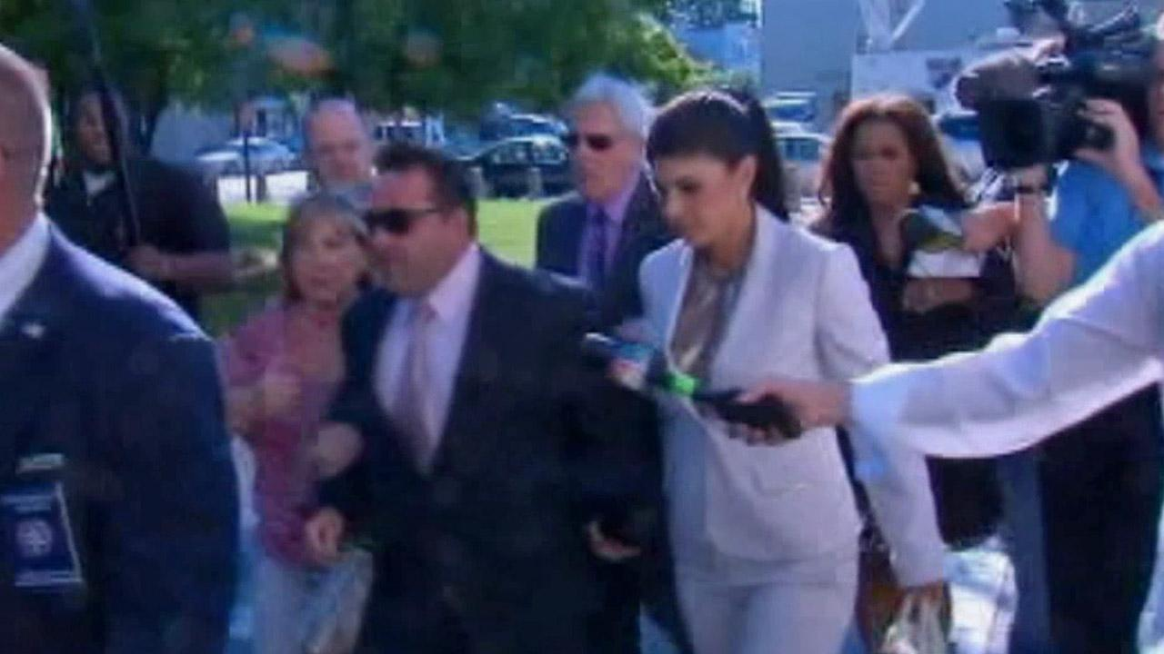 RHONJs Teresa Giudice and husband leave a N.J. court on July 30, 2013. They face federal fraud charges.