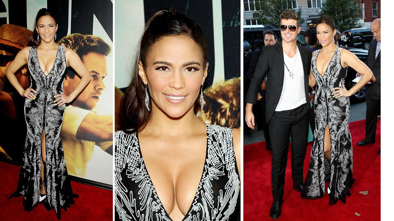 Paula Patton and husband Robin Thicke attend the premiere of the film 2 Guns at the SVA Theatre in New York on July 29, 2013.