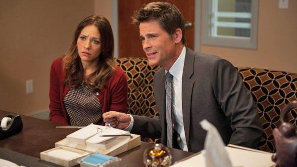 Rob Lowe and Rashida Jones apper in a scene from the Jerrys Scrapbook episode of Parks and Recreation, which aired on April 18, 2013. - Provided courtesy of Colleen Hayes/NBC