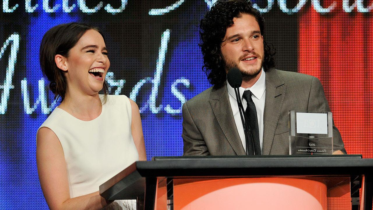 Emilia Clarke, left, and Kit Harington, cast members in the HBO series Game of Thrones, accept the award for Outstanding Achievement in Drama at the 2013 TCA Awards at the Beverly Hilton Hotel on Saturday, Aug. 3, 2013 in Beverly Hills, California.