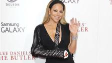 Mariah Carey wears black dress, studded sling to Butler premiere. - Provided courtesy of OTRC / Kristina Bumphrey/ startraksphoto.com