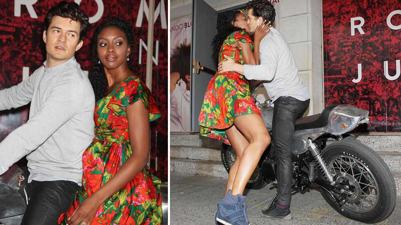 Orlando Bloom and Condola Rashad, stars of the upcoming Broadway production of Romeo and Juliet, kiss on a motorcycle in New York on Aug. 7, 2013. They had just arrived at the shows new home, the Richard Rodgers Theatre, for the first time.