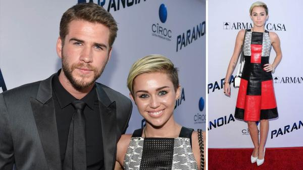 Miley Cyrus and Liam Hemsworth appear at the Los Angeles premiere of Paranoia on Aug. 8, 2013. - Provided courtesy of Frazer Harrison/Getty Images for Relativity Media / Sara De Boer/startraksphoto.com