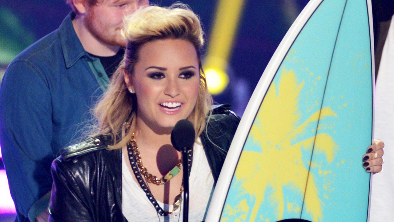 Demi Lovato accepts the choice female TV personaity: female award at the Teen Choice Awards at the Gibson Amphitheater on Sunday, Aug. 11, 2013, in Los Angeles.