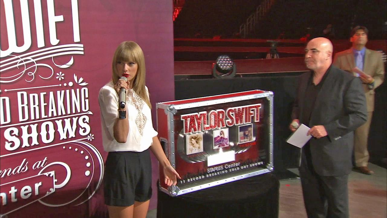 Taylor Swift appears at a press conference at Staples Center in Los Angeles on Aug. 20, 2013. She was presented with a Tiffany cuff bracelet and a plaque for setting the record for having the most sold-out shows for a solo artist.