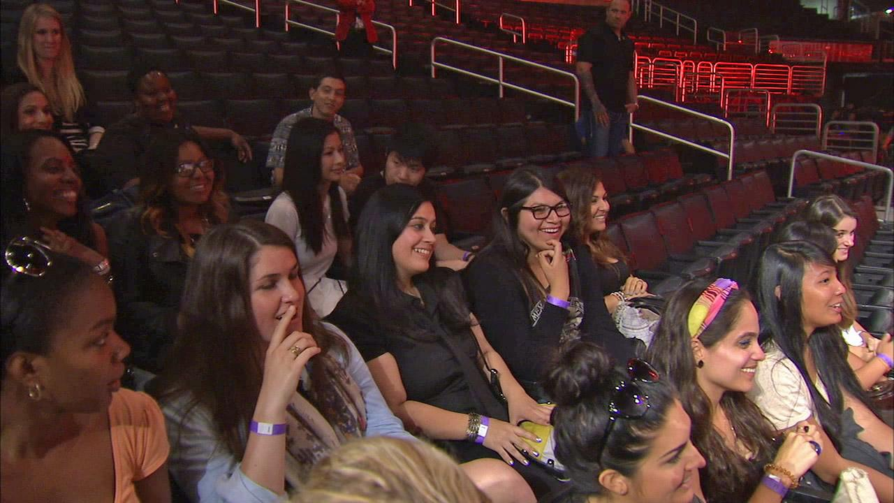 Taylor Swift surprised these college students, members of the Grammy U group, with free tickets to her concert at Staples Center on Aug. 20, 2013. Swift was honored by the arena for having sold out 11 concerts there over the court of her career.