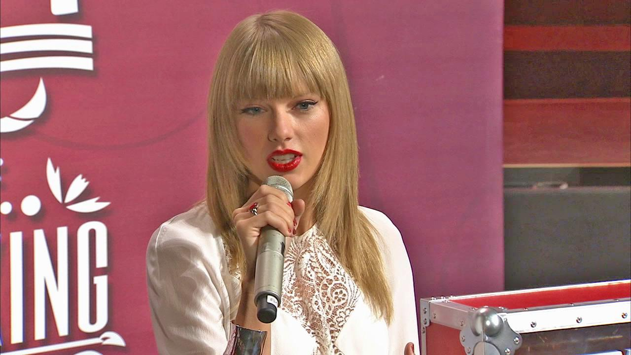 Taylor Swift surprises 20 college students, members of the Grammy U group, with free tickets to her concert at Staples Center on Aug. 20, 2013. Swift was honored by the arena for having sold out 11 concerts there over the court of her career.