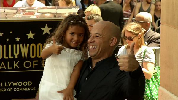 Vin Diesel and his daughter, Hania Riley, stand on the star he received on the Hollywood Walk of Fame on Aug. 26, 2013.