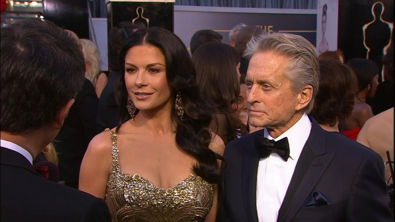 Catherine Zeta-Jones and Michael Douglas walk the red carpet at the 2013 Oscars on Sunday, Feb. 24.