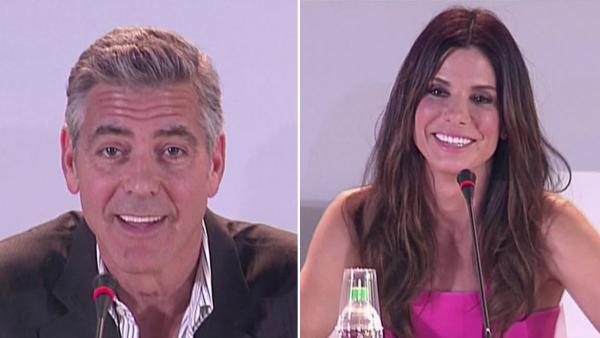 Sandra Bullock and George Clooney appear at a press event in Venice