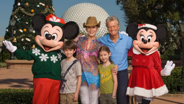 Catherine Zeta-Jones and Michael Douglas pose with their children, Dylan (left), age 10, and Carys (right), age 7, on Nov. 24, 2010, along with Mickey Mouse and Minnie Mouse in front of the Epcot th