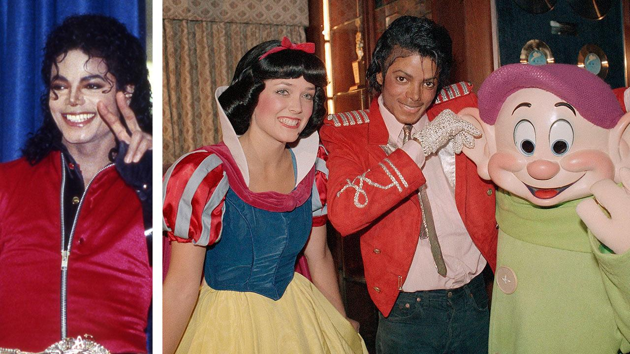 Michael Jackson visits his old Los Angeles school, Gardner Street Elementary School, and flashes the victory sign on Wednesday, Oct. 11, 1989. Michael Jackson poses with Disney characters Snow White and Dopey at his familys home on April 27, 1984.