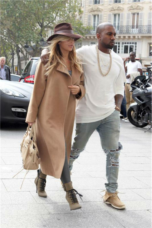 "<div class=""meta ""><span class=""caption-text "">Kim Kardashian and Kanye West walk the streets of Paris during Paris Fashion Week on Sept. 28, 2013. (Rex Features / Beretta / Sims / Startraksphoto.com)</span></div>"