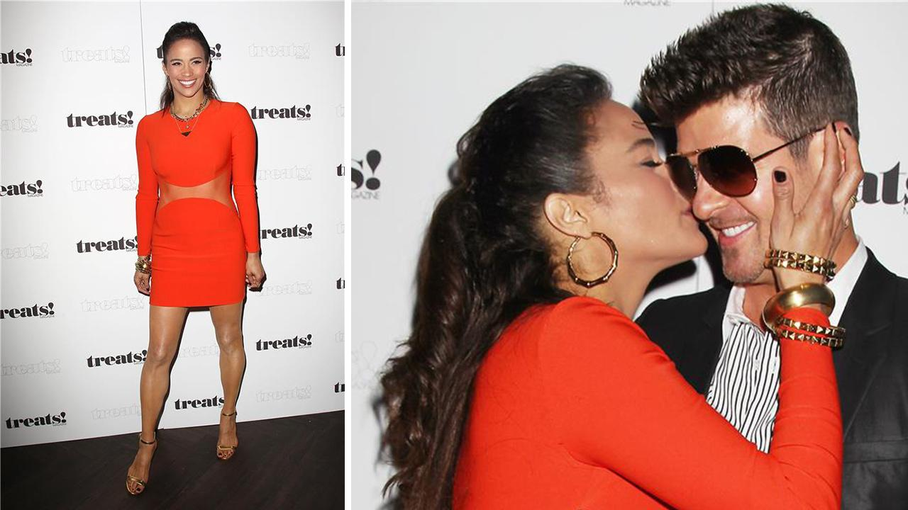 Paula Patton and Robin Thicke kiss at a release party for his album Blurred Lines held at the No. 8 nightclub in New York and hosted by Treats! magazine on Sept. 4, 2013.