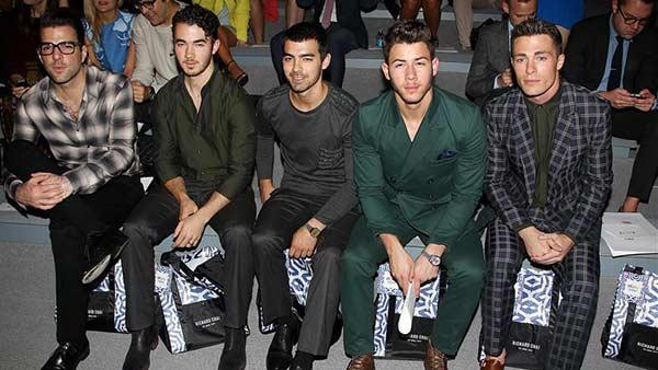 Zachary Quinto, Jonas Brothers members Kevin, Joe and Nick Jonas and Teen Wolf actor Colton Haynes sit together at Richard Chais fashion show at Lincoln Center in New York, part of the Spring 2014 Mercedes-Benz Fashion Week, on Sept. 5, 2013. - Provided courtesy of Amanda Schwab / Startraksphoto.com