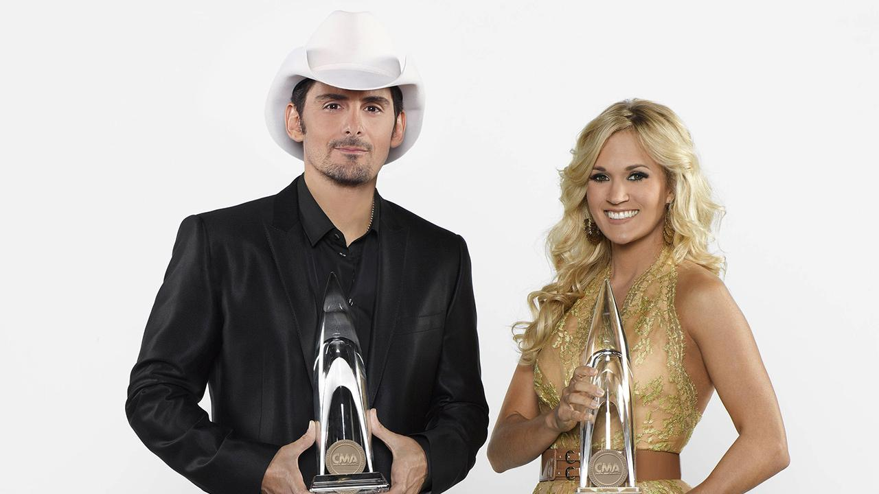 Brad Paisley and Carrie Underwood appear in a publicity photo for the 2013 CMA Awards.