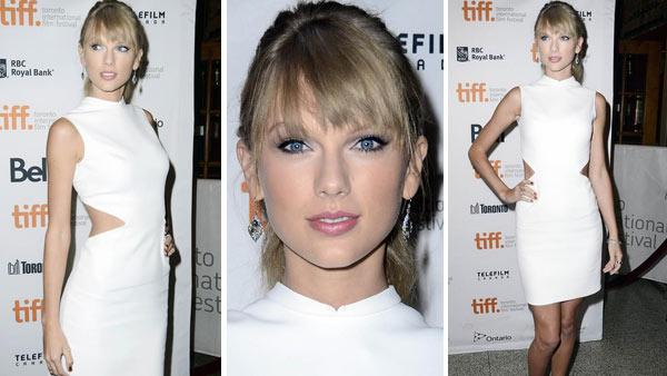 Taylor Swift rocks a sexy white Calvin Klein dress at the Toronto International Film Festival premiere of One Chance on Sept. 9, 2013. - Provided courtesy of Christian Lapid / Startraksphoto.com
