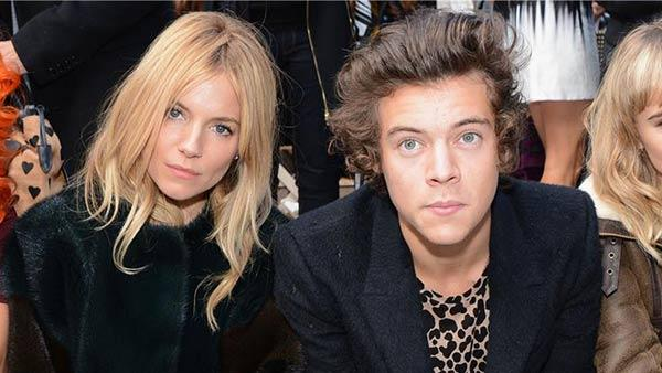 One Direction singer Harry Styles watches the Burberry Prorsum Spring / Summer 2014 fashion show with Sienna Miller during London Fashion Week fashion show on Sept. 16, 2013. - Provided courtesy of Richard Young / Rex / Startraksphoto.com