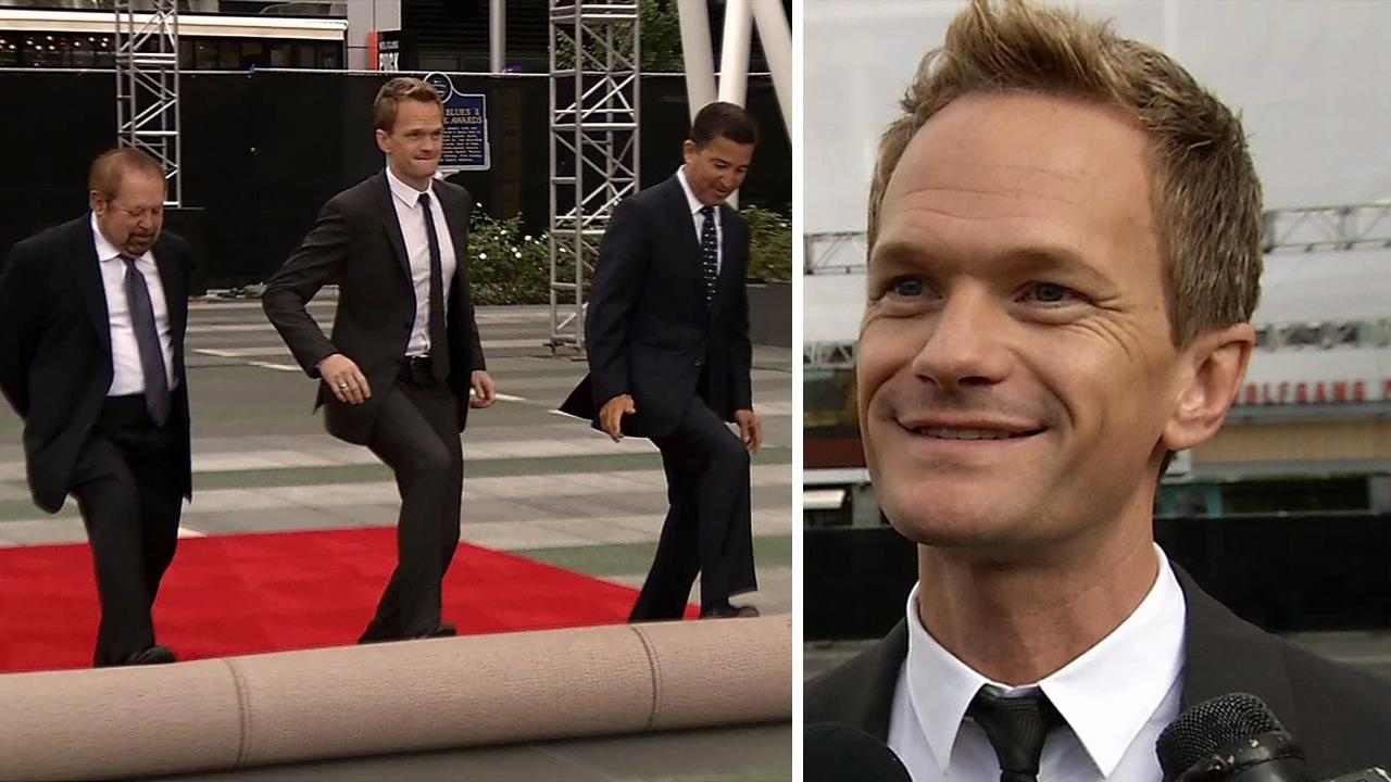 Neil Patrick Harris helps roll out the Emmys 2013 red carpet near L.A. Lives Nokia Theatre on Sept. 18, 2013, four days before the award show. / Neil Patrick Harris talks to OTRC.com after helping to roll out the 2013 Emmy Awards red carpet.