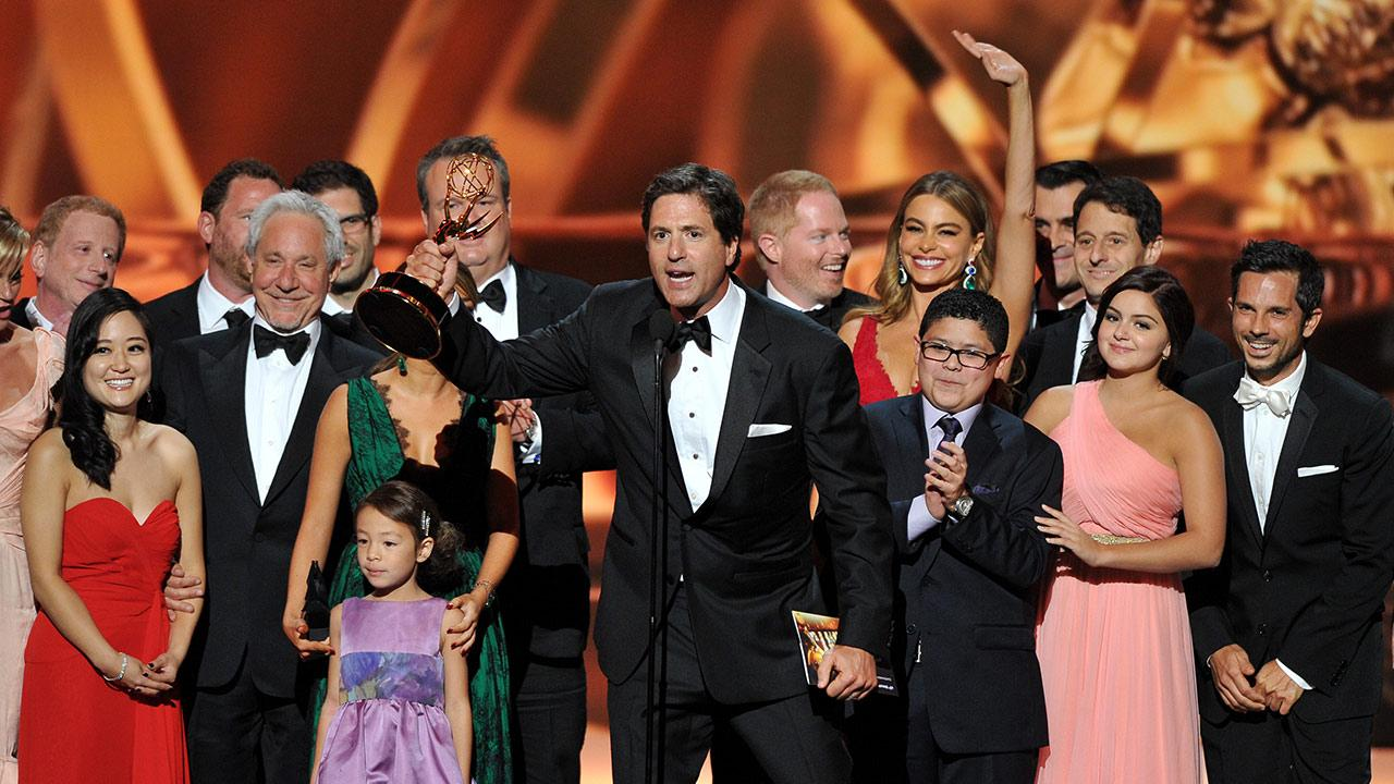 Steven Levitan, center, and the cast and crew of Modern Family accept the award for Outstanding Comedy Series at the 65th Primetime Emmy Awards at Nokia Theatre on Sunday Sept. 22, 2013, in Los Angeles.