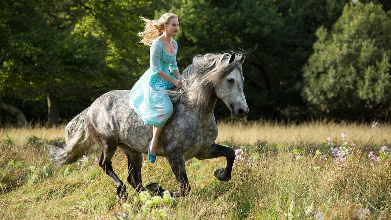 Lily James appears as Cinderella in a scene from Walt Disney Pictures 2015 live-action film Cinderella.