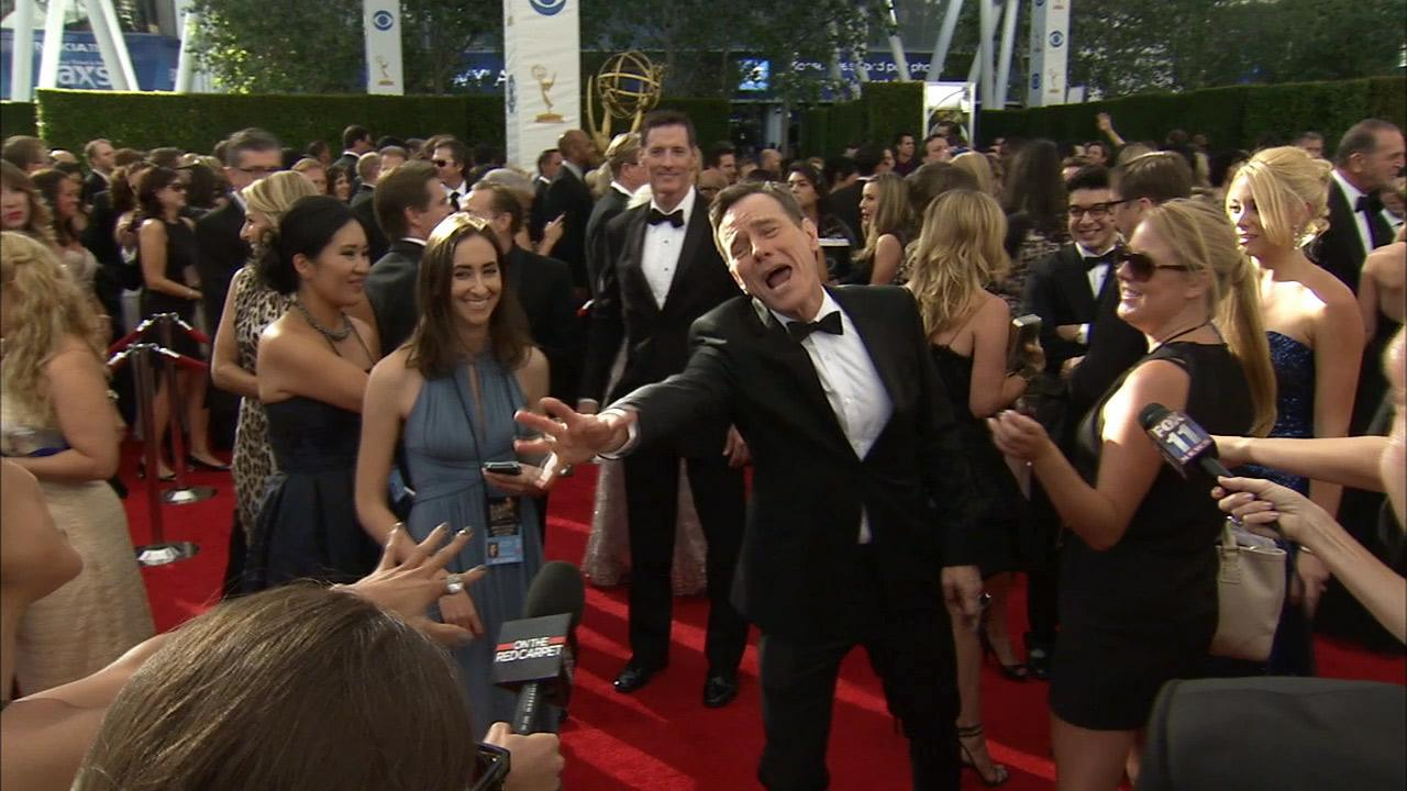 Breaking Bad star Bryan Cranston demonstrates kinetic energy to OTRC.com on the red carpet at the 2013 Emmys on Sept. 22, 2013.
