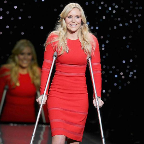 Lindsey Vonn, a champion ski racer and 2010 Olympic Gold medalist, walks the runway in crutches at the Go Red For Women&#47;The Heart Truth Red Dress 2014 Collection fashion show during Mercedes-Benz Fashion Week in New York on Feb. 6, 2014. She had suffered injuries in 2013 and underwent knee surgery in November, which forced her to miss competing in the 2014 Winter Olympics in Sochi, Russia. She is wearing a design by Cynthia Rowley. <span class=meta>(Amanda Schwab &#47; Startraksphoto.com)</span>