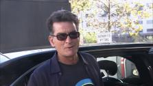 Charlie Sheen reports for jury duty in Los Angeles on Sept. 24, 2013. - Provided courtesy of OTRC