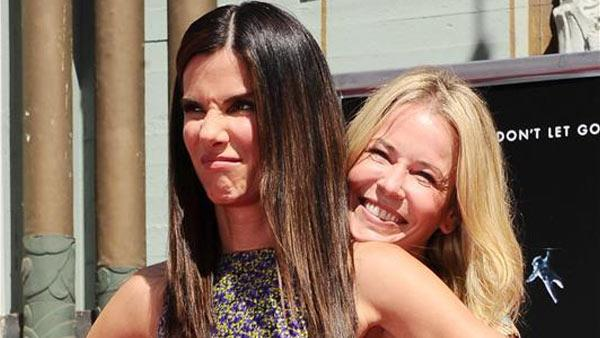 Sandra Bullock appears with comedienne Chelsea Handler at the TCL Chinese Theatre in Los Angeles, California on Sept. 25, 2013 for a commemorative hand and footprint ceremony. - Provided courtesy of Sara De Boer / startraksphoto.com