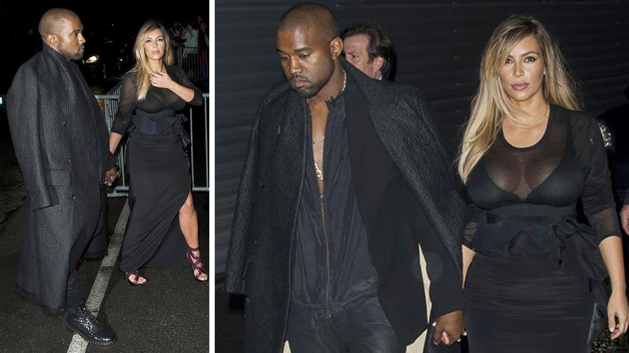 Kim Kardashian and Kanye West attend the Givenchy Spring/Summer 2014 Ready-To-Wear Collection fashion show during Paris Fashion Week in Paris, France on Sept. 29, 2013.
