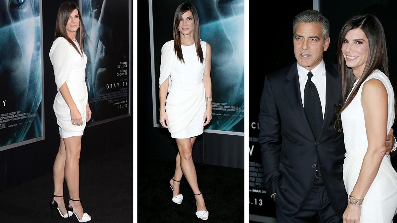 George Clooney and Sandra Bullock appear at the premiere of Gravity at AMC Lincoln Square in New York on Oct. 1, 2013.
