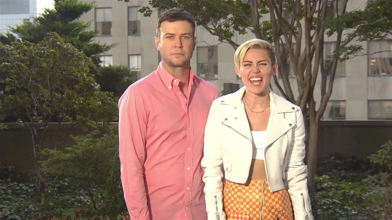 Miley Cyrus appears with Taran Killam in a promotional video for the NBC show SNL, in an episode set to air on Oct. 5, 2013.